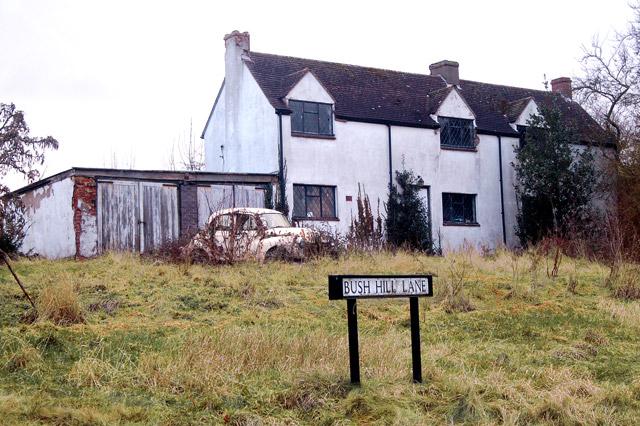 Dilapidated cottages and rusting Morris Minor, Bush Hill Lane, Flecknoe