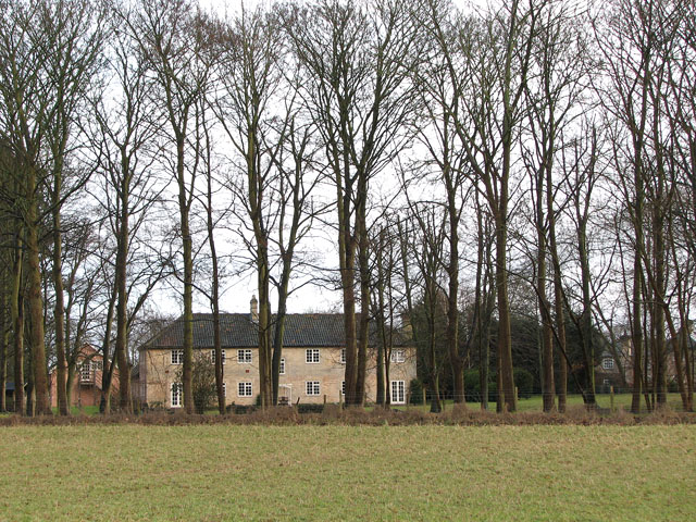 House behind tall trees, West Harling