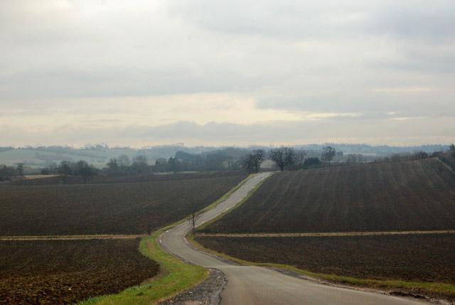 Road across a ploughed landscape south of Flecknoe