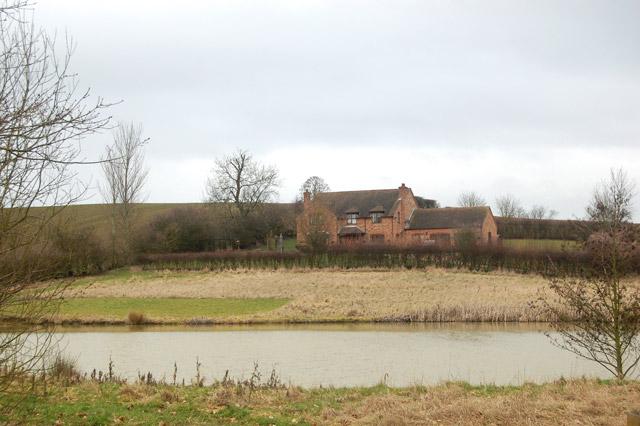 New house and pond south of Flecknoe