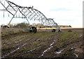 TL9787 : Sprinkler in field north of Roudham Road by Evelyn Simak