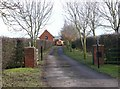 SP3460 : Entrance drive to Field Barn from Fosse Way by David P Howard