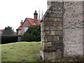 SK8059 : Holme: buttress and pantiled house by John Sutton