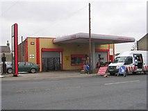SE1527 : Crown Garage - Huddersfield Road by Betty Longbottom