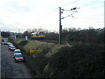 NT2774 : Locomotive passing Clockmill Lane by kim traynor