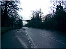 TQ0070 : View up Egham Hill towards the Royal Holloway footbridge by Robert Lamb