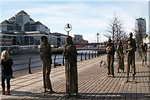 O1634 : Surrounded by signs of economic progress - the Famine Memorial on Custom House Quay by Eric Jones