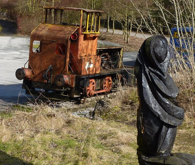Shunter by Rolls Royce and a wooden carved lady