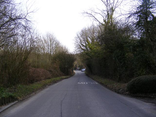 Approaching Peasenhall Crossroads on Mill Hill