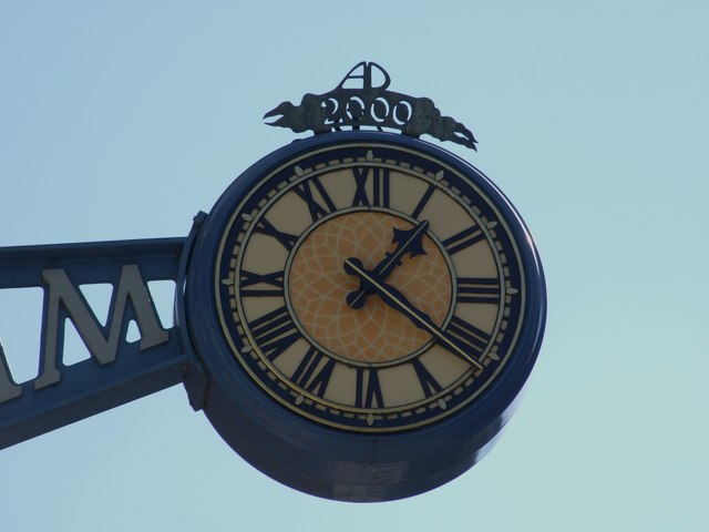 Millennium Clock Hanging from The Library in Teme Street Tenbury Wells