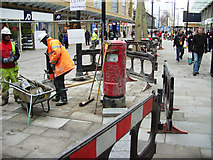 SU1484 : Installing a postbox, Canal Walk, Swindon (4 of 4) by Brian Robert Marshall