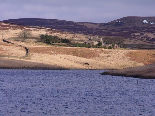 View across Walshaw Dean Lower Reservoir to the Lodge