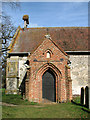 TM1581 : St Andrew's church - the south porch by Evelyn Simak