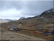 SH6358 : Rocky outcrops and marshy ground near Llyn y Cŵn by Jeremy Bolwell