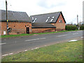 TM1681 : Barn conversions by Manor House, The Street, Dickleburgh by Evelyn Simak