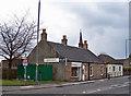 NS8190 : Shops in Quakerfield, Bannockburn by Richard Dorrell