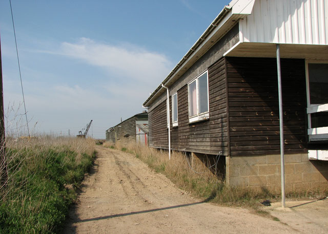 Path past boatyard sheds beside the River Waveney in St Olaves