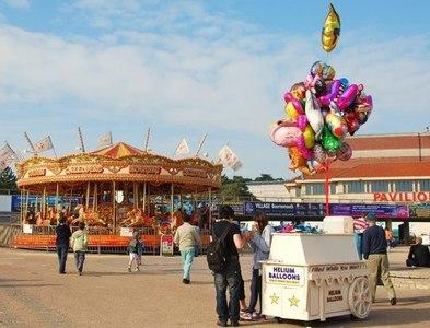 SZ0890 : Bournemouth: Amusements near the Pavilion by Eugene Birchall