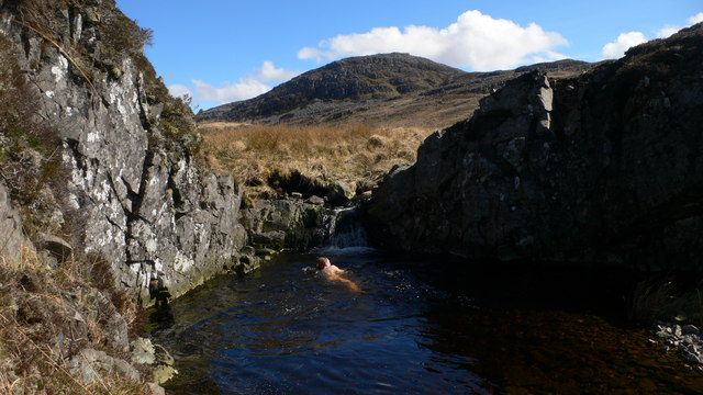 A bracing dip in a plunge pool on the Allt an Tairbh