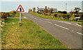 J4699 : Staggered crossroads sign, Islandmagee by Albert Bridge
