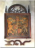 TF5617 : All Saints church in Tilney All Saints - royal arms by Evelyn Simak