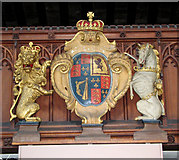TF5002 : St Peter's church - royal arms on the west gallery by Evelyn Simak