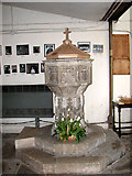 TF5002 : St Peter's church - C15 baptismal font by Evelyn Simak