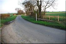 TF0933 : Dry ford at Birthorpe by John Walton