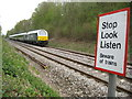 SU9790 : Jordans: Birchland Wood railway foot crossing (2) by Nigel Cox