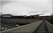 SJ9495 : Footbridge over the motorway by Bill Boaden