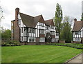 TQ1981 : Mock-Tudor flats round a lawn, Monks Drive by David Hawgood