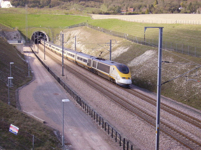 A Eurostar emerges from the North Downs Tunnel