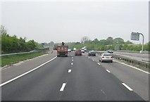 SU4726 : M3 crossing the railway line by Sandy B