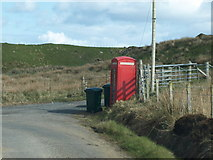 NR3143 : Phone box at Risabus by Andrew Abbott