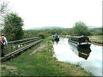 SJ9065 : Crossing the weir bridge on the Macclesfield Canal by Raymond Knapman