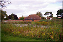 TG0934 : Pond and Village Hall, Edgefield, Norfolk by Christine Matthews