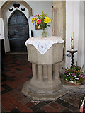 TM1273 : St Mary's church in Yaxley - baptismal font by Evelyn Simak