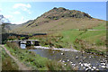 NY4419 : Footbridge and ford over Fusedale Beck by Rob Burke