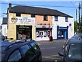 W8873 : Opticians and mobile phone shops, Main Street, Midleton/Mainistir na Corann, Town Parks Townland by Mac McCarron