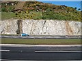 J0823 : Exposed bedrock on the approach to the Newry slip road by Eric Jones