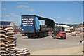 TQ5357 : Stacking the Lorry by Oast House Archive