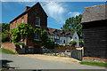 SP0356 : Farmhouse in Knighton by Philip Halling