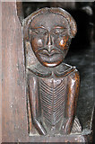 TF7928 : St Martin's church in Houghton - C17 bench end by Evelyn Simak