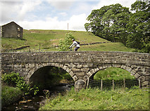 SD9532 : Bridge over Alcomden Water by michael ely
