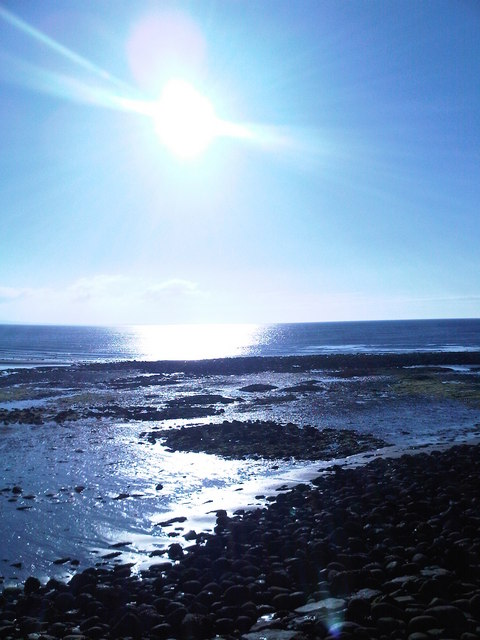 Early morning sunshine across Dundrum Bay