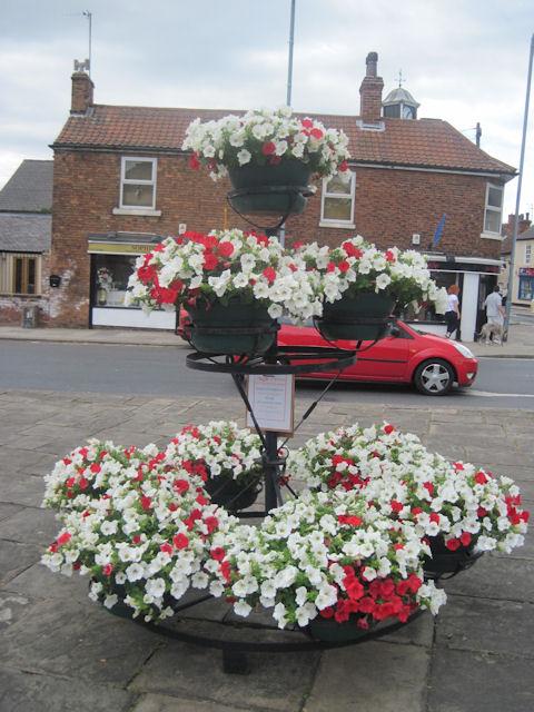 Flower display at Tickhill Market Cross