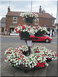 SK5993 : Flower display at Tickhill Market Cross by John Firth