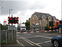 TQ1875 : Train crossing Manor Road by Stephen Craven