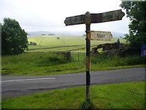 NY6407 : Signpost at Raisbeck by Colin Smith
