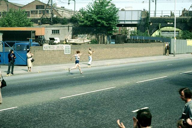 Hugh Jones runs up Butcher Row, 1982